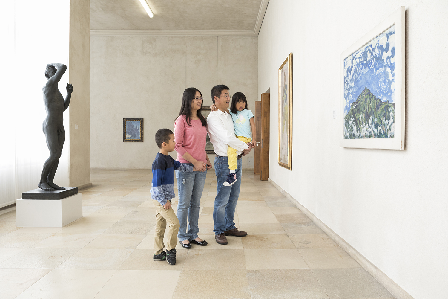 Chinese Family looking at painting